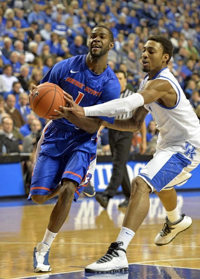 Kentucky's James Young, right, attempts to strip the ball away from Boise State's Mikey Thompson during the first half of an NCAA college basketball game Tuesday, Dec. 10, 2013, in Lexington, Ky. (AP Photo/Timothy D. Easley)