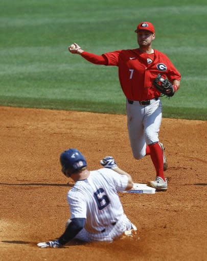 Georgia shortstop Cam Shepherd (7) throws to first for the double play as Mississippi's Thomas Dillard (6) slides into second base during the third inning of a Southeastern Conference Tournament NCAA college baseball game, Thursday, May 24, 2018, in Hoover, Ala. (AP Photo/Butch Dill)