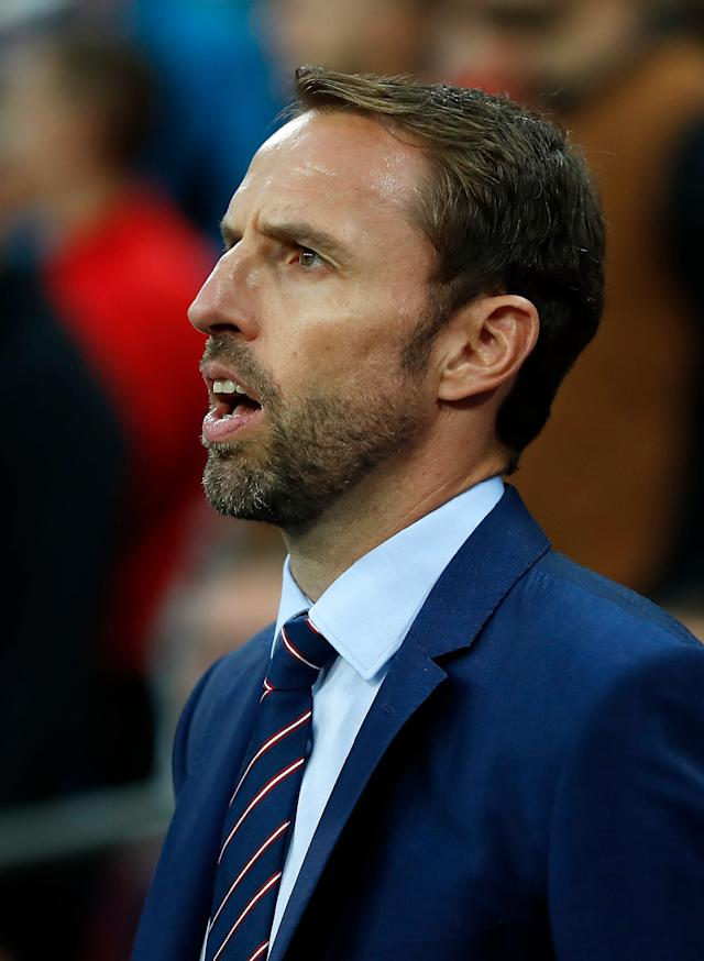 <p>England's manager Gareth Southgate sings the anthem prior the World Cup Group F qualifying soccer match between England and Slovakia at Wembley Stadium in London, England, Monday, Sept. 4, 2017. (AP Photo/Kirsty Wigglesworth) </p>