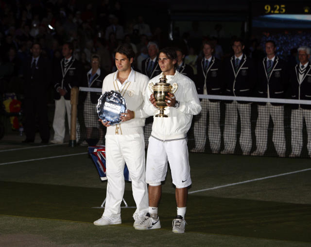 FILE - In this Sunday, July 6, 2008 file photo Spain's Rafael Nadal right, stands with the winners trophy next to Switzerland's Roger Federer after the men's singles final on the Centre Court at Wimbledon. After going more than 1 years without playing each other anywhere, Roger Federer and Rafael Nadal will be meeting at a second consecutive Grand Slam tournament when they face off in Wimbledon's semifinals. (AP Photo/Kirsty Wigglesworth, File)