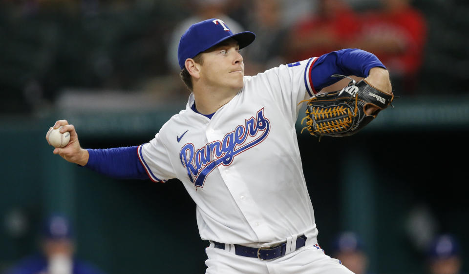 Texas Rangers starting pitcher Spencer Howard throws during the first inning of a baseball game against the Chicago White Sox, Saturday, Sept. 18, 2021, in Arlington, Texas. (AP Photo/Brandon Wade)