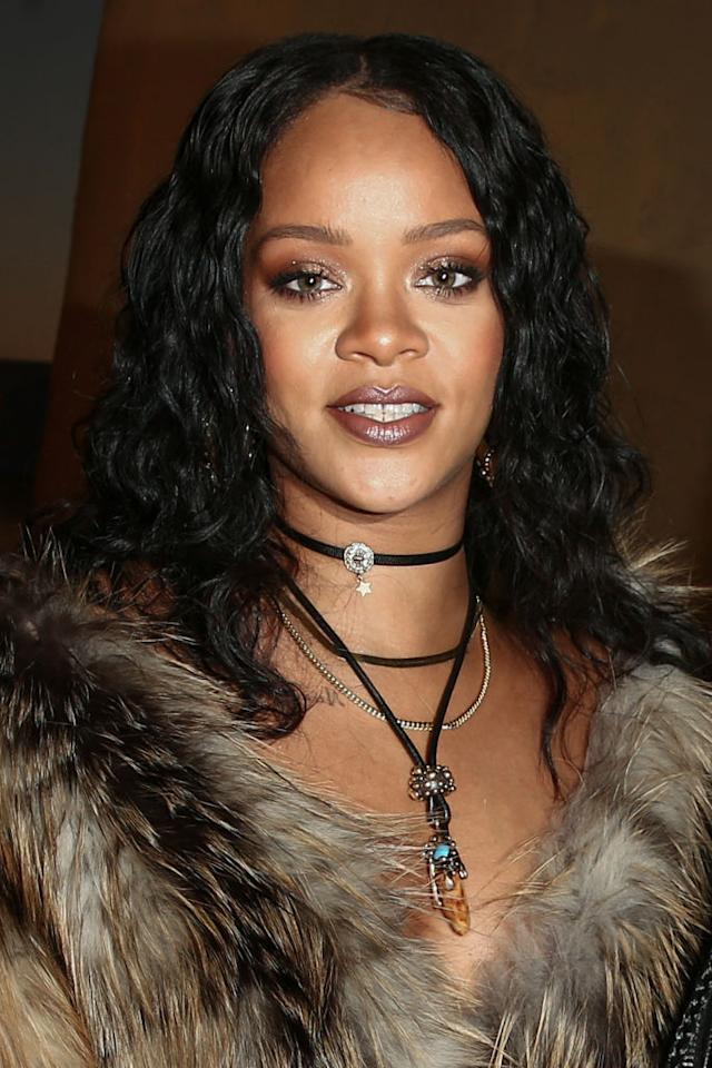 <p>Rihanna looked bronzed and beautiful sitting front row at the Dior Cruise show. The rich tones in her makeup accentuate her green eyes and full lips. (Photo: Rich Fury/Getty Images) </p>