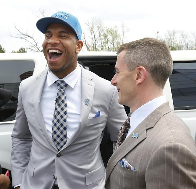 Detroit Lions first round draft choice, 10th overall, North Carolina tight end Eric Ebron, left, smiles with team president Tom Lewand after arriving at the team's headquarters in Allen Park, Mich., Friday, May 9, 2014. (AP Photo/Paul Sancya)