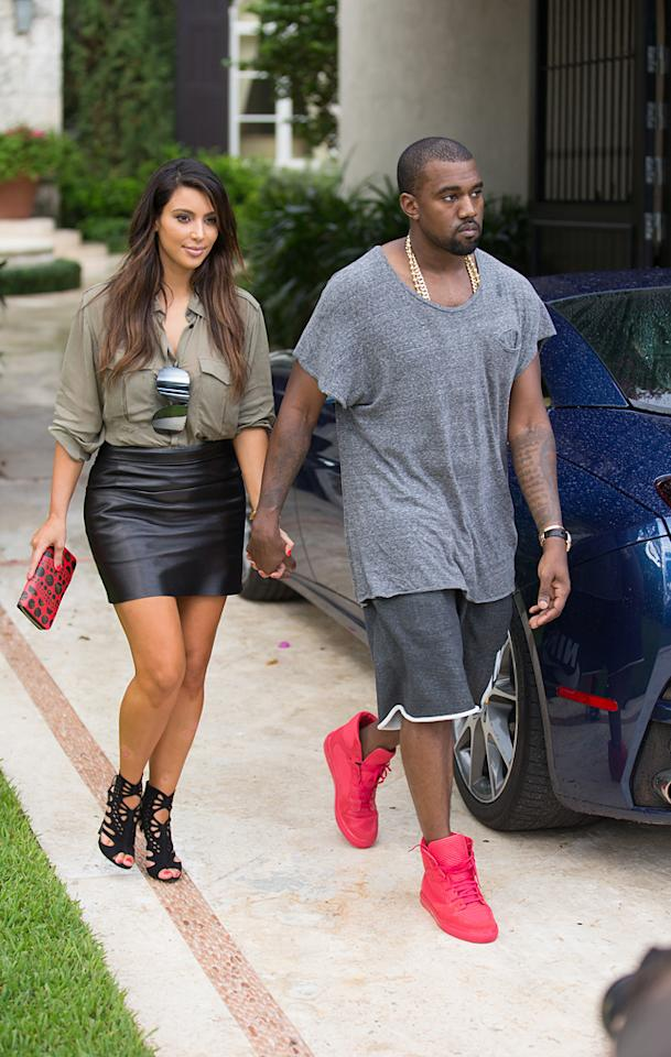 """Kim Kardashian and Kanye West spent Monday afternoon holding hands as they strolled through a Miami neighborhood looking at houses. The 31-year-old -- who's in town filming """"Kourtney and Kim Take Miami"""" -- tweeted: """"Miami fun day with @kanyewest.""""(10/8/12)"""