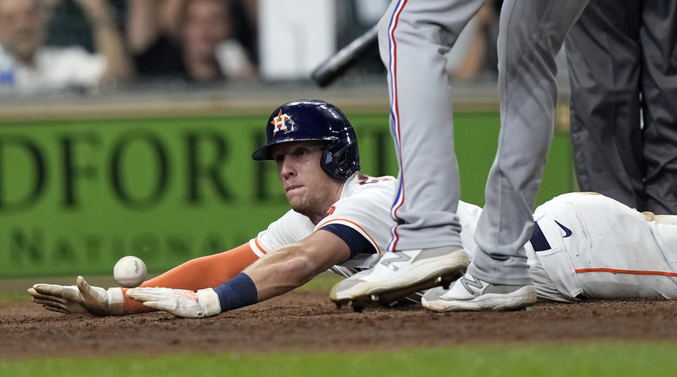 Houston Astros' Myles Straw scores on a wild pitch by Texas Rangers relief pitcher Brett Martin during the 11th inning of a baseball game Thursday, May 13, 2021, in Houston. The Astros won 4-3 in 11 innings. (AP Photo/David J. Phillip)