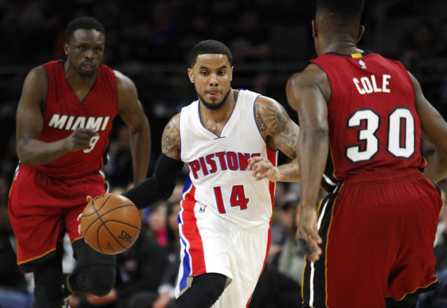 Detroit's D.J. Augustin drives against Miami's Norris Cole as Luol Deng trails the play. (Raj Mehta-USA TODAY Sports)
