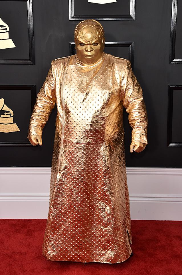 "<p>CeeLo Green — who has won five Grammys — has a new alter ego. His name is Gnarly Davidson, and for the Grammys, he sort of looked like a gold version of the Hulk. (<a rel=""nofollow"" href=""https://www.yahoo.com/celebrity/stars-celebrate-pre-grammy-parties-slideshow-wp-013319814/photo-p-ceelo-green-debuted-interesting-photo-013319561.html"">Last night</a>, he was decked out in silver and black.) The singer seemed to have a good time working his way down the Grammys carpet, knocking cameras out of the way, though the inspiration behind the new identity is still unknown. For now, let's just agree this is no Sasha Fierce. (Photo: John Shearer/WireImage) </p>"