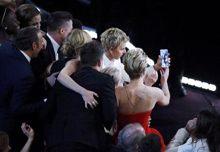 Host Ellen Degeneres takes a group picture at the 86th Academy Awards in Hollywood, California March 2, 2014. REUTERS/Lucy Nicholson