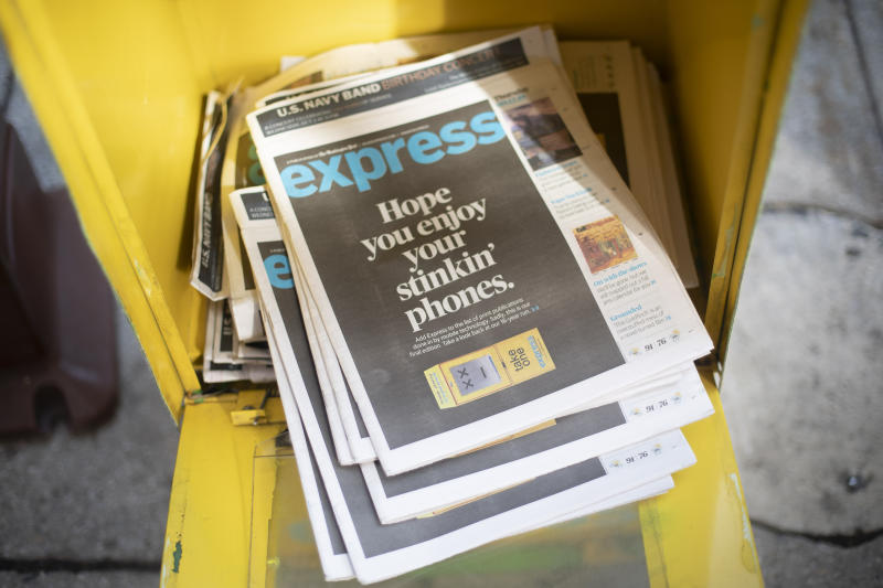 Final copies of the free commuter paper, Express, are seen in a newspaper box outside McPherson Square Metro Station in downtown Washington, Thursday, Sept. 12, 2019. The Washington Post announced yesterday that it has decided to cease publication of its Express commuter paper, that has been handed out for free at Metro stations for 16 years. (AP Photo/Pablo Martinez Monsivais)