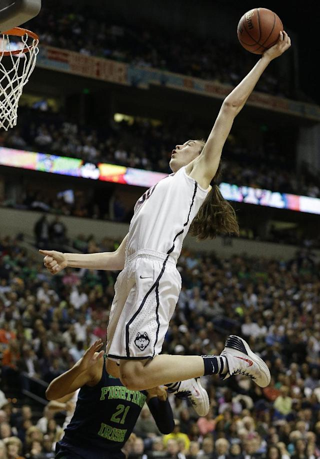 Connecticut forward Breanna Stewart (30) shoots against Notre Dame guard Kayla McBride (21) during the first half of the championship game in the Final Four of the NCAA women's college basketball tournament, Tuesday, April 8, 2014, in Nashville, Tenn. (AP Photo/Mark Humphrey)