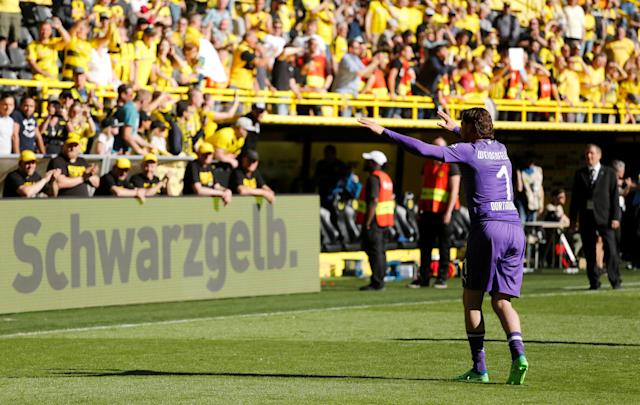 Soccer Football - Bundesliga - Borussia Dortmund vs 1.FSV Mainz 05 - Signal Iduna Park, Dortmund, Germany - May 5, 2018 Borussia Dortmund's Roman Weidenfeller salutes their fans after the match REUTERS/Leon Kuegeler DFL RULES TO LIMIT THE ONLINE USAGE DURING MATCH TIME TO 15 PICTURES PER GAME. IMAGE SEQUENCES TO SIMULATE VIDEO IS NOT ALLOWED AT ANY TIME. FOR FURTHER QUERIES PLEASE CONTACT DFL DIRECTLY AT + 49 69 650050