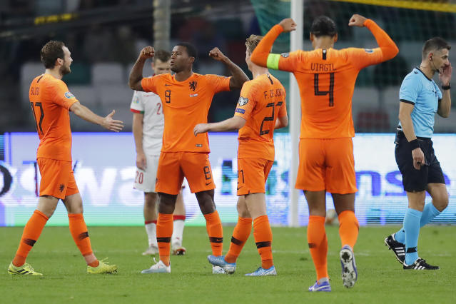 Netherlands' Giliano Wijnaldum, second from left, celebrates after scoring a goal during the Euro 2020 group C qualifying soccer match between Belarus and Netherlands at the Dinamo stadium in Minsk, Belarus, Sunday, Oct. 13, 2019. (AP Photo/Sergei Grits)