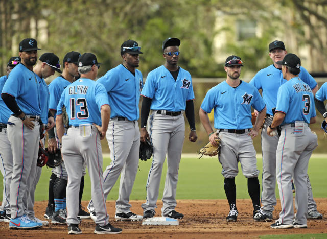 Miami Marlins third base coach Trey Hillman (3) talks with his players during the spring training workout at Roger Dean Stadium on Thursday, February 20, 2020 in Jupiter, Fla. (David Santiago/Miami Herald via AP)