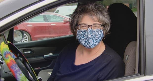 Bethea Reznik, who owns a private car service, picks up passengers from a parking lot closest to the U.S. border after they're dropped off by an American taxi. Reznik says she's making about two round trips from Toronto each week.