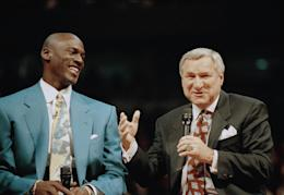 Michael Jordan and Dean Smith share a moment during a ceremony. (AP)