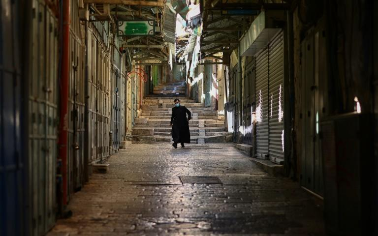 Renewed lockdowns and curfews have left streets empty in cities around the world like Jerusalem