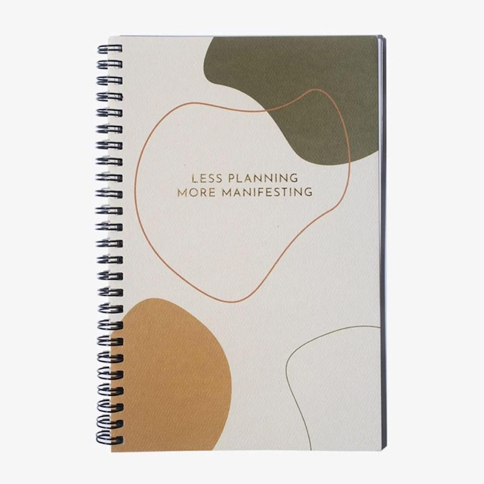 "If you want to write your own way, gift yourself this manifestation journal made from 100% recycled paper (choose between line or unlined). It's totally blank inside, so you can doodle, plan, or use it as a diary. Either way, it'll look pretty resting on your desk space or bedside table. $24, Package Free Shop. <a href=""https://packagefreeshop.com/products/manifestation-journal"" rel=""nofollow noopener"" target=""_blank"" data-ylk=""slk:Get it now!"" class=""link rapid-noclick-resp"">Get it now!</a>"