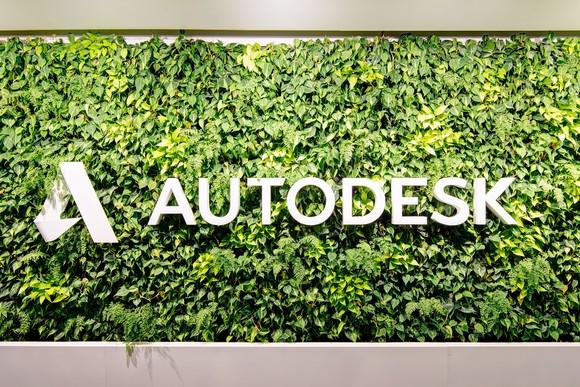 Autodesk logo and sign surrounded by greenery.