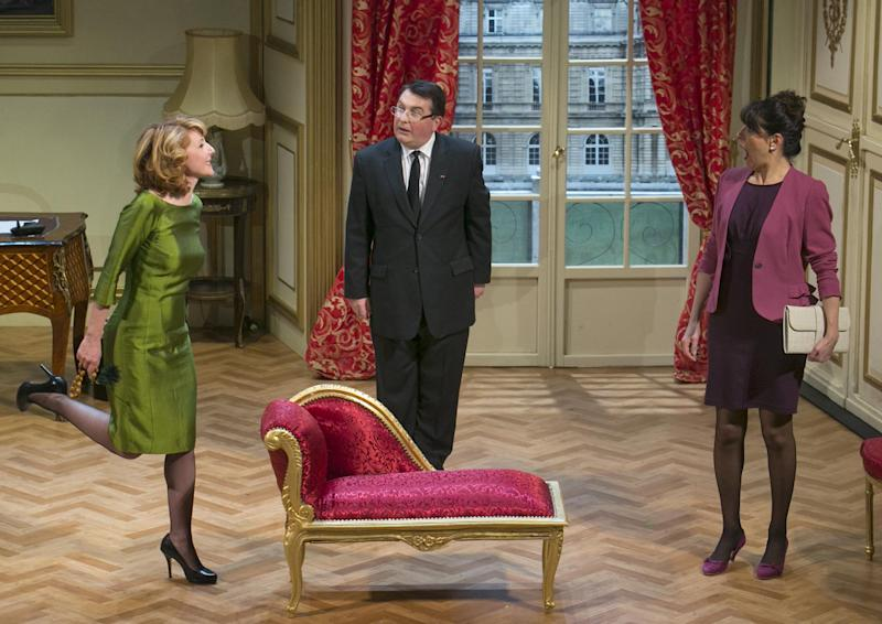 "In this photo taken Tuesday, Feb. 19, 2013, French actors Daniel-Jean Colloredo, center, Marie Piton, left, and Dominique Merot perform in a scene of ""Mr. Normal, His Women and Me,"" directed by Bernard Uzan, at the Tristan Bernard theater in Paris, France. A vow to keep his private life out of the public eye helped sweep Francois Hollande to power last year as France's president, attracting voters tired of his flashy predecessor's amorous exploits. Now, the words of the one-time dull Socialist are back to bite him in a new play. (AP Photo/Jacques Brinon)"