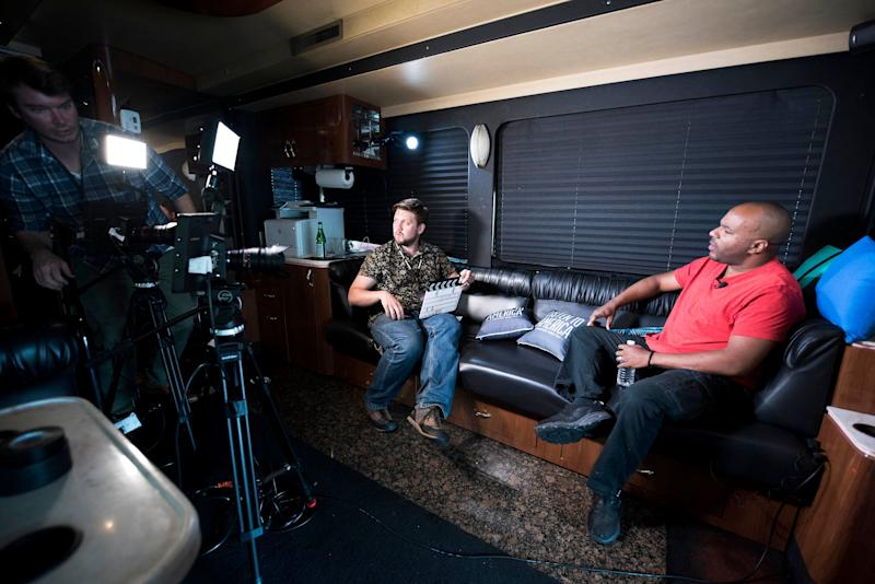 Producer Will Tooke prepares to conduct an interview on the bus with David Wraith of Sex Positive St. Louis.