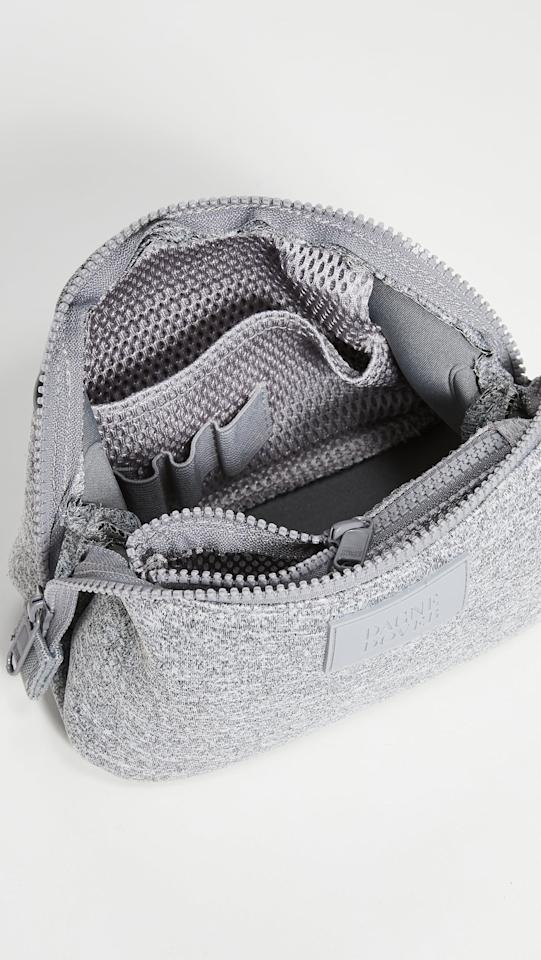 """<p>This <a href=""""https://www.popsugar.com/buy/Dagne-Dover-Hunter-Toiletry-Bag-Small-547349?p_name=Dagne%20Dover%20Hunter%20Toiletry%20Bag%20Small&retailer=shopbop.com&pid=547349&price=35&evar1=savvy%3Aus&evar9=46228223&evar98=https%3A%2F%2Fwww.popsugar.com%2Fsmart-living%2Fphoto-gallery%2F46228223%2Fimage%2F46228399%2FDagne-Dover-Hunter-Toiletry-Bag-Small&list1=shopping%2Ctravel%2Ceditors%20pick%2Ctravel%20tips%2Ctravel%20style&prop13=mobile&pdata=1"""" rel=""""nofollow"""" data-shoppable-link=""""1"""" target=""""_blank"""" class=""""ga-track"""" data-ga-category=""""Related"""" data-ga-label=""""https://www.shopbop.com/hunter-toiletry-bag-small-dagne/vp/v=1/1560529308.htm?fm=search-viewall&amp;os=false&amp;ref=SB_PLP_NB_10"""" data-ga-action=""""In-Line Links"""">Dagne Dover Hunter Toiletry Bag Small</a> ($35) has so many useful pockets that help me keep my products more organized. </p>"""
