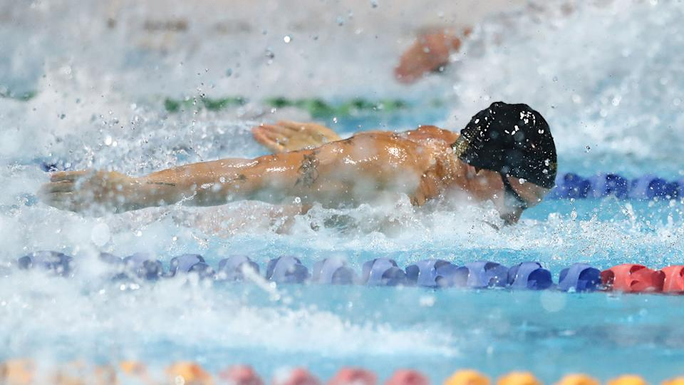 Pictured here, Cody Simpson races in the 50m butterfly at the Australian Swimming Championships.