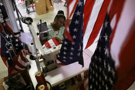 Sylvia Bull cuts and sews U.S. flags at Valley Forge's manufacturing facility in Lane, South Carolina June 23, 2015.  REUTERS/Brian Snyder