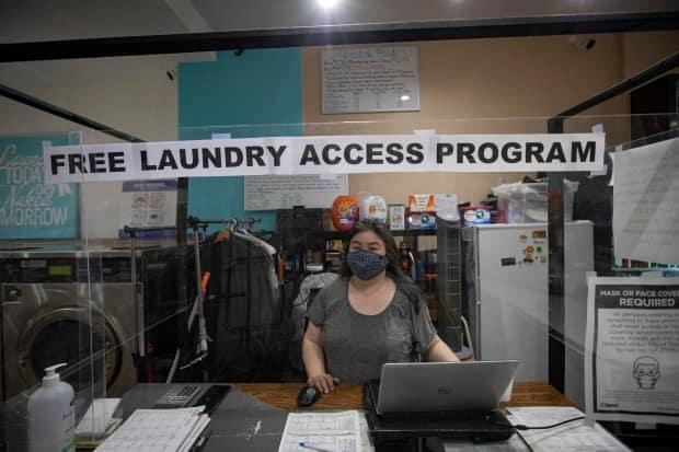 Nancy Seto, who co-owns Yummi Cafe Laundromat in Toronto, is pictured on March 11, 2021. Seto and her husband organized a program to help cover the costs of doing laundry for those hardest-hit by the COVID-19 pandemic. (EVAN MITSUI - image credit)