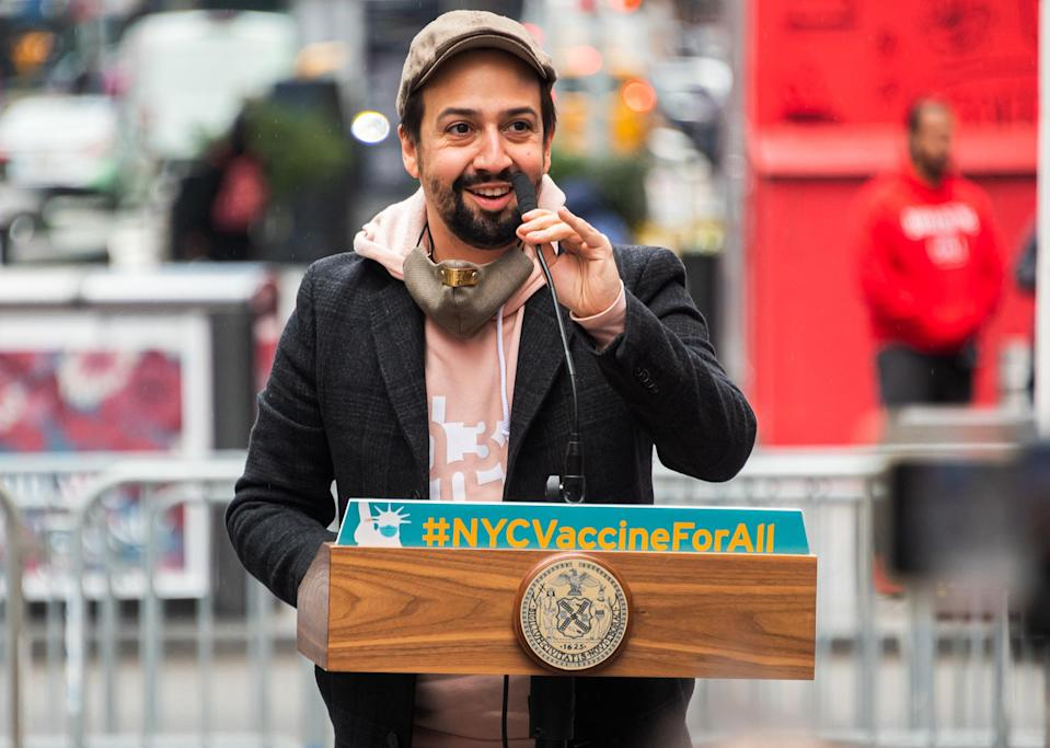 <p>Lin-Manuel Miranda takes the podium at the opening of a vaccination center for Broadway workers in N.Y.C.'s Times Square on Monday.</p>
