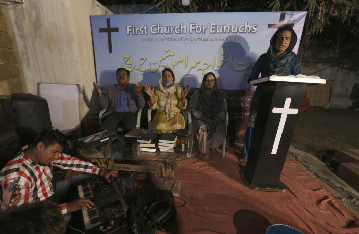Nisara Gill, right, leads a prayer service at Pakistan's first church for transgender worshippers, in Karachi, Pakistan, Friday, Nov. 13, 2020. Transgender Pakistanis are often mocked, abused and bullied, and Christians among them are a minority within a minority, often shunned even in churches. (AP Photo/Fareed Khan)
