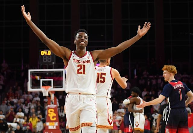 """USC's Onyeka Okongwu acknowledges the crowd after a win over Arizona at Galen Center on Feb. 27. <span class=""""copyright"""">(Jayne Kamin-Oncea / Getty Images)</span>"""