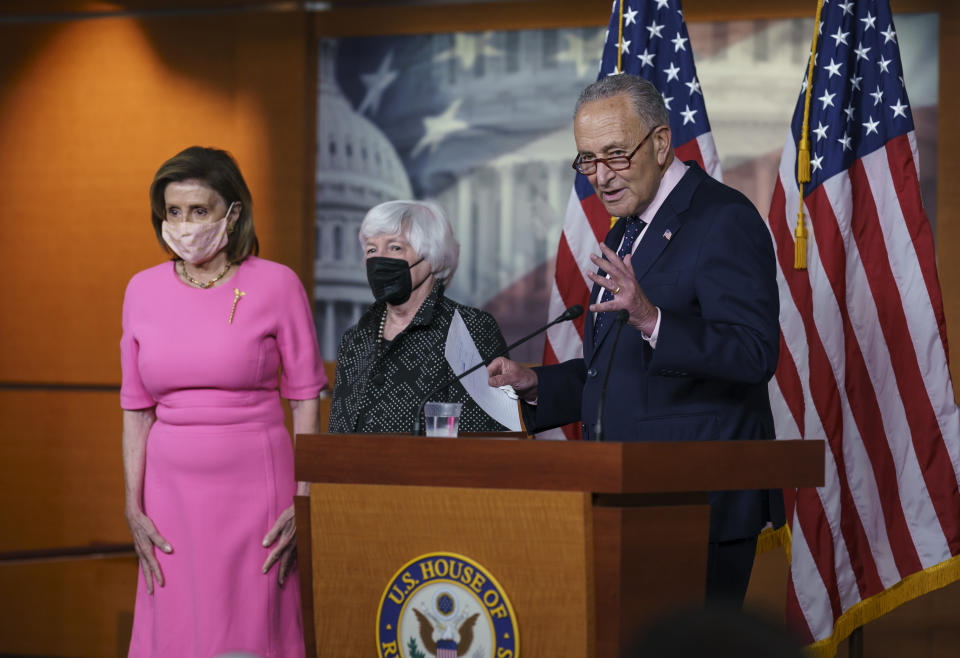 """From left, Speaker of the House Nancy Pelosi, D-Calif., Treasury Secretary Janet Yellen and Senate Majority Leader Chuck Schumer, D-N.Y., update reporters on Democratic efforts to pass President Biden's """"Build Back Better"""" agenda, at the Capitol on Thursday."""