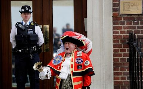 Town Crier Tony Appleton announces that the Duchess of Cambridge has given birth to a baby boy outside the Lindo wing at St Mary's Hospital in London - Credit: AP Photo/Kirsty Wigglesworth