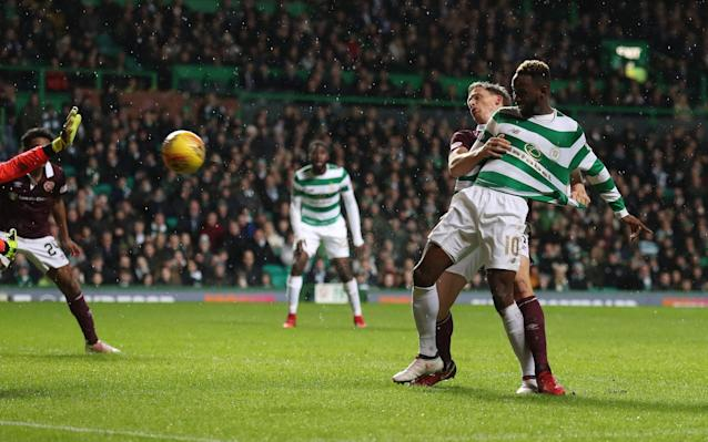 Celtic's response to criticism of recent tepid performances was a comprehensive demolition of Heart of Midlothian in which Moussa Dembele – whose future has been the subject of much speculation during the transfer window – was a pivotal figure. After acting as provider to Odsonne Edouard and Dedryck Boyata, Dembele scored Celtic's third before half time. Kyle Lafferty prevented a whitewash with a second half strike but it was no more than a punctuation in Celtic's progress, which saw them move 14 points ahead of Rangers in the Scottish Premiership table, having played a game more than the Ibrox side. The lash of wind-driven rain on a dark night in the east end of Glasgow was supplemented by the prospect of an edge in this contest, which saw Celtic face the team who ended their extraordinary run of 69 games unbeaten in successive domestic fixtures on December 17 at Tynecastle. To add to the intrigue, both sides had been unbeaten since then, with Hearts conceding only the first goal in that passage against Motherwell at the weekend. They were to shop one so promptly on this occasion that Craig Levein and his players could have been under no illusions about Celtic's desire to extract revenge for last month's setback. Hearts' hope that they could again impose their pressing game on the champions was evident from an energetic opening which saw them probe the Hoops defence from both flanks, with some degree of menace. Hearts presumably derived comfort and ambition from the absence of such Celtic regulars as Craig Gordon in goal and Leigh Griffiths up front. Certainly, their first cross from the right saw Gordon's replacement, Dorus de Vries, come off his line without making contact. Any encouragement that visitors might have drawn from this jaunty start was quashed instantly, as Celtic struck with a sucker punch set up by Dembele and finished with a predatory left-foot finish by his attacking partner, Edouard. Dedryck Boyata makes it 2-0 from close range Credit: PA Dembele's role as provider continued when Boyata doubled Celtic's advantage after 24 minutes. The central defender had shifted upfield for a free kick and was still prowling around the box when he gathered a pass from his French colleague and took a touch before driving low between Jon McLaughlin and his near post. Ten minutes before the interval, Dembele joined the scoring spree after Kieran Tierney had shredded the right edge of Hearts' defence to deliver a cutback which the striker rifled into the net. Those who had wondered where Dembele's mind had been located in recent weeks – the Premier League being implied – could not help but note his emphatic celebrations, not only at his goal but also after his assists. Hearts, who badly needed a break, were struck a double blow as the game approached the midway mark. First, they lost Harry Cochrane – the teenager who scored against Celtic at the age of 16 last month – and then Ross Callachan, who were replaced by Prince Buaben and Danny Amankwaa respectively. For a spell in the second half, Hearts looked as though they were about to be swamped by waves of pressure featuring Dembele, Edouard and Olivier Ntcham and their propsects looked even bleaker when Celtic introduced their much-touted loan signing from Chelsea, Charly Musonda, who replaced James Forrest just after an hour. Instead, against expectation and the run of play, Hearts reduced the deficit when Lafferty fastened on to a loose ball and struck a curling shot past De Vries. This turn of events prompted Hearts' most promising passage of the evening, although they remained conspicuously vulnerable at the back.