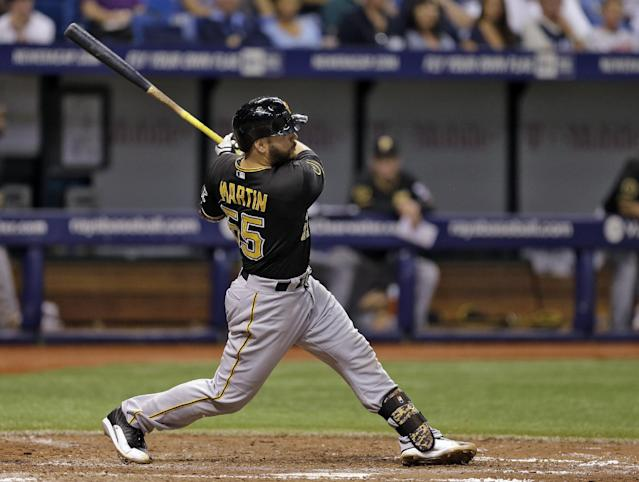 Pittsburgh Pirates' Russell Martin follows the flight of his home run off Tampa Bay Rays relief pitcher Brad Boxberger during the eighth inning of an interleague baseball game Tuesday, June 24, 2014, in St. Petersburg, Fla. (AP Photo/Chris O'Meara)