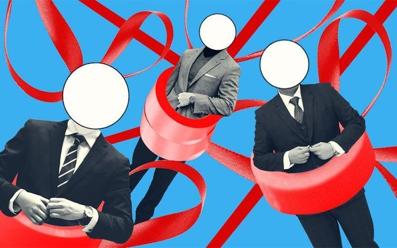 Businessmen covered in red tape.