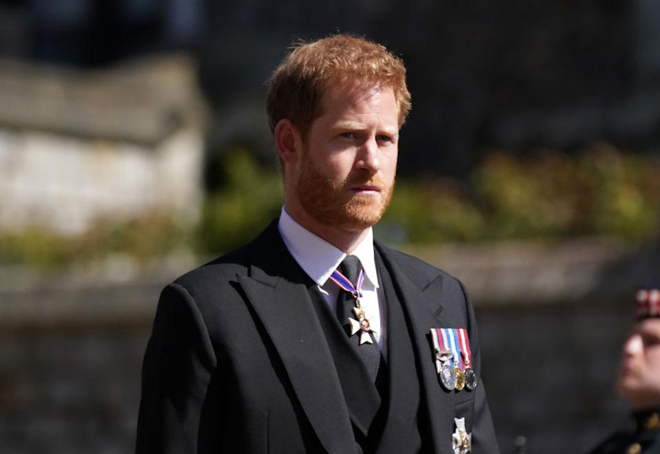 Prince Harry walking in the procession at Windsor Castle, Berkshire, during the funeral of the Duke of Edinburgh. Picture date: Saturday April 17, 2021. PA Photo. See PA story FUNERAL Philip. Photo credit should read: Victoria Jones/PA Wire