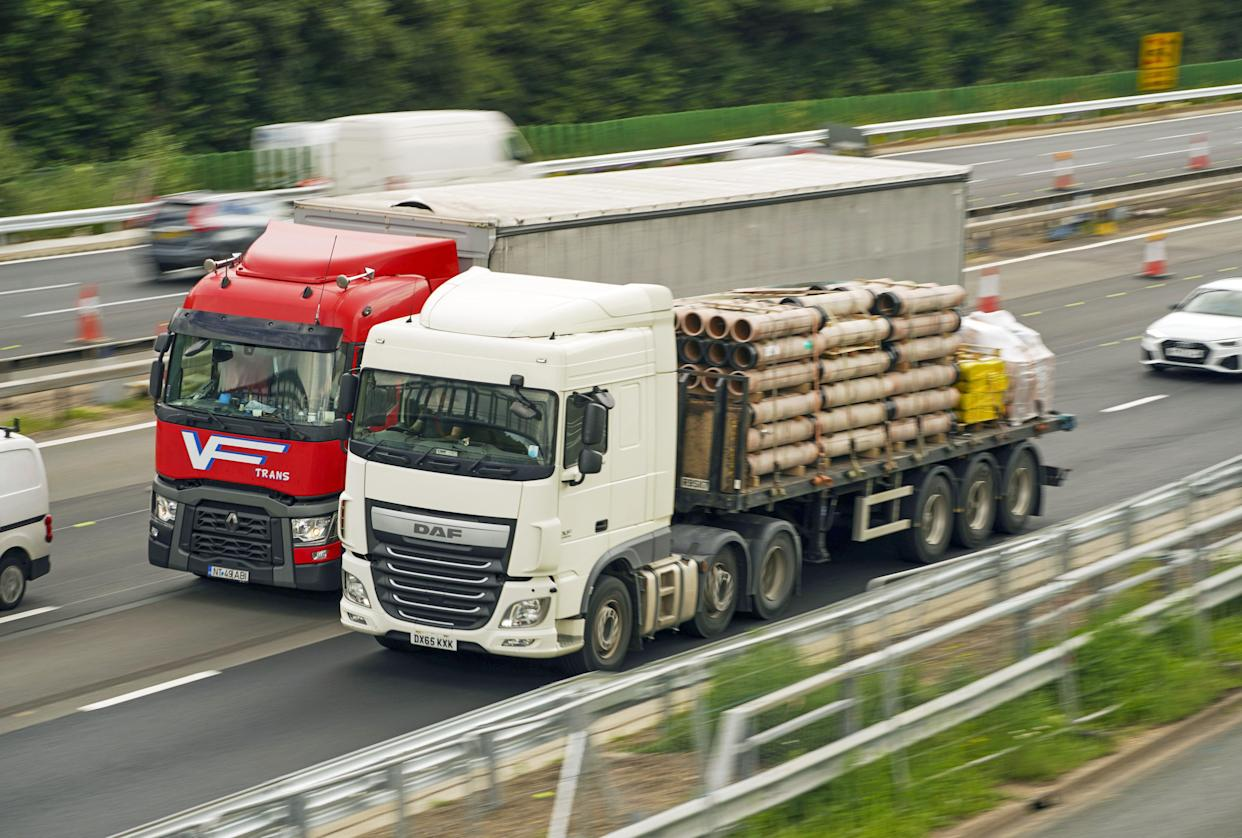 HGV lorries on the M4 motorway near Datchet, Berkshire. The Government has announced a temporary extension to lorry drivers' hours from Monday July 12th, amid a shortage of workers. Picture date: Thursday July 8, 2021.