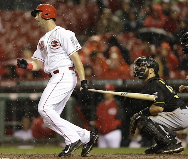 Cincinnati Reds' Ryan Ludwick hits a two-run home run off Pittsburgh Pirates starting pitcher Wandy Rodriguez in the fourth inning of a baseball game, Monday, April 14, 2014, in Cincinnati. (AP Photo/Al Behrman)