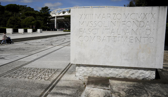 The word DVCE, which was Benito Mussolini's title, is written on the mosaic pavement of the The Piazzale at the Foro Italico sporting complex in Rome, Monday, May 6, 2019, next to a plaque commemorating the founding of Mussolini's Fasci Italiani di Combattimento (Italian Fighting Fasces) on March 23, 1919. The Foro Italico, formerly called Foro Mussolini (Mussolini's Forum) was built under Mussolini's regime to bolster Rome's bid for the Olympics in the 1940's. (AP Photo/Andrew Medichini)