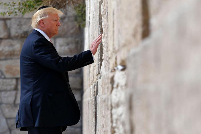 <p>MAY 22, 2017 – President Donald Trump visits the Western Wall in Jerusalem's Old City. (Photo: Mandel Ngan/AFP/Getty Images) </p>