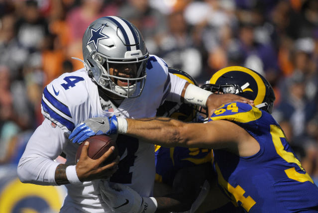 Dallas Cowboys quarterback Dak Prescott, left, is sacked by Los Angeles Rams linebacker Bryce Hager and another defender during the first half of a preseason NFL football game Saturday, Aug. 17, 2019, in Honolulu. (AP Photo/Mark J. Terrill)