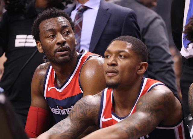 """<a class=""""link rapid-noclick-resp"""" href=""""/nba/teams/was"""" data-ylk=""""slk:Washington Wizards"""">Washington Wizards</a> teammates <a class=""""link rapid-noclick-resp"""" href=""""/nba/players/4716/"""" data-ylk=""""slk:John Wall"""">John Wall</a> and <a class=""""link rapid-noclick-resp"""" href=""""/nba/players/5009/"""" data-ylk=""""slk:Bradley Beal"""">Bradley Beal</a> are looking in different directions. (Getty Images)"""