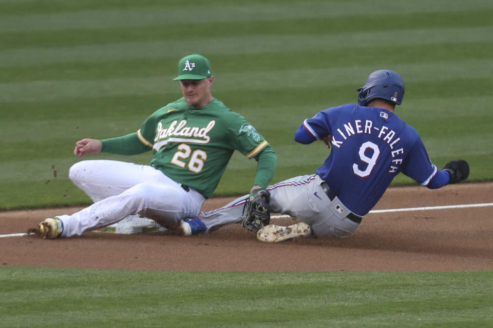 Oakland Athletics third baseman Matt Chapman tags out Isiah Kiner-Falefa of the Texas Rangers on an attempted steal during the third inning of a baseball game in Oakland, Calif., Tuesday, Aug. 4, 2020. (AP Photo/Jed Jacobsohn)