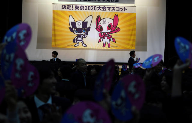"FILE - In this Feb. 28, 2018, file photo, the characters which will serve as mascot for the Tokyo 2020 Olympic and Paralympic Games, are unveiled, in Tokyo. John Coates, the head of the International Olympic Committee inspection team visiting Tokyo as it prepares for the 2020 Olympics, warned local organizers on Monday, April 23, 2018 to get ready for some complaints. Coates says organizers are entering a phase where questions from stakeholders become very pragmatic and very urgent. The sign reads: "" Decision! Mascots for the Tokyo 2020 Games."" (AP Photo/Eugene Hoshiko, File)"