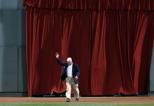 """Former Boston Red Sox great Carl Yastrzemski waves as he emerges from a red curtain in the outfield during ceremonies honoring the """"All-Time Fenway Team"""" prior to a baseball game against the Tampa Bay Rays at Fenway Park in Boston, Wednesday, Sept. 26, 2012. (AP Photo/Elise Amendola)"""