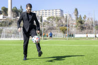 """Moshe Hogeg, one of the owners of Beitar Jerusalem FC soccer club, plays with a ball, in the team training ground in Jerusalem, Sunday, Dec. 27, 2020. The owner of Israel's Beitar Jerusalem soccer club has given himself an ambitious task. Weeks after bringing in a wealthy Emirati investor as co-owner, Hogeg says he is determined to remove the stain of racism from his team. Beitar is the only major Israeli team never to have signed an Arab player, and its fans have been known to make racist chants at matches. Hogeg says he and his Emirati partner aim to turn the team into both an Israeli soccer powerhouse and a model of coexistence. """"We are actively looking for A-class players,"""" he says. """"Religion is not a factor by any means."""" (AP Photo/Ariel Schalit)"""