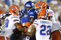 Kentucky quarterback Will Levis, center, fights through the Florida defense during the second half of an NCAA college football game in Lexington, Ky., Saturday, Oct. 2, 2021. (AP Photo/Michael Clubb)