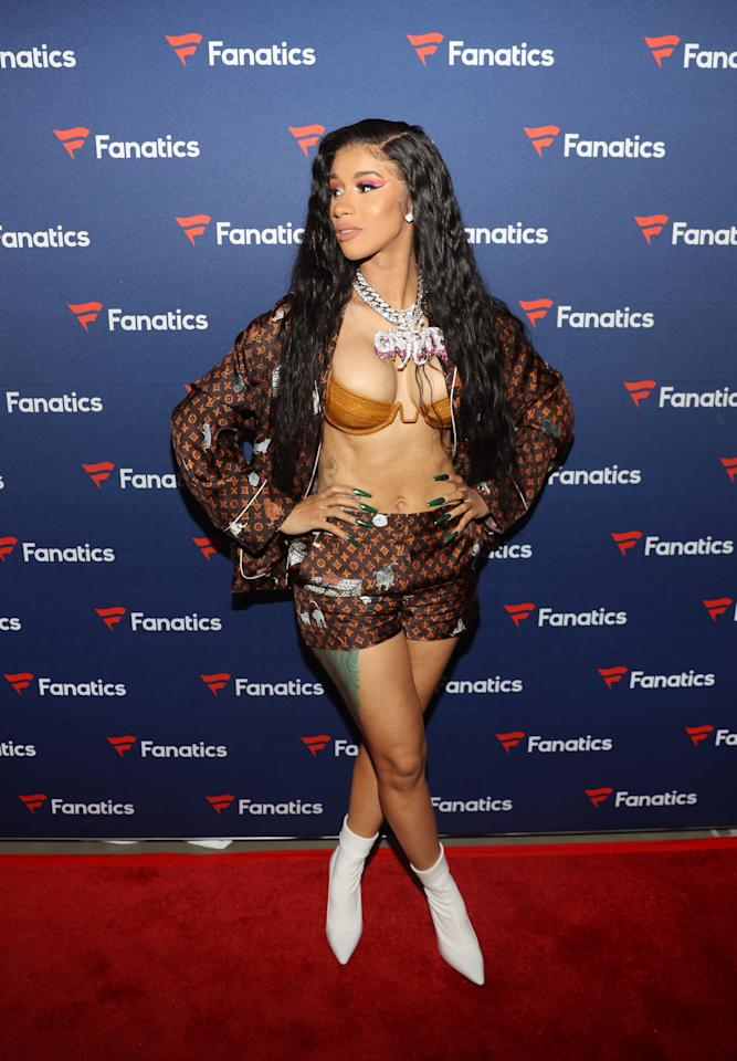 <p>For Michael Rubin's Fanatics Super Bowl LIII Party in Atlanta, Cardi B flaunted her figure in a Louis Vuitton monogrammed button-down top and matching shorts along with a barely-there gold bra.</p>