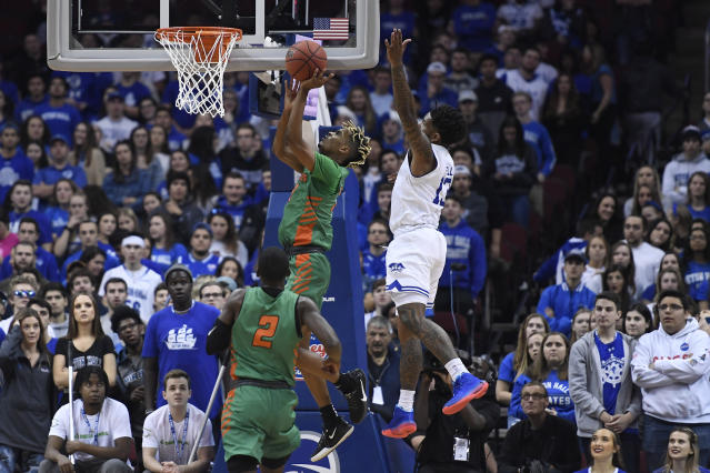 Florida A&M guard MJ Randolph (3) attempts a basket as Seton Hall guard Myles Powell (13) defends during the second half of an NCAA college basketball game, Saturday, Nov. 23, 2019 in Newark, N.J. (AP Photo/Sarah Stier)